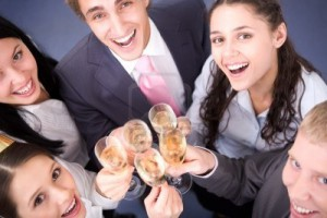 6107284-photo-of-happy-friends-cheering-up-during-corporate-party